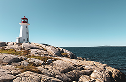 Canadian maritimes lighthouse by ocean