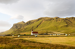 Iceland view of hills with a church