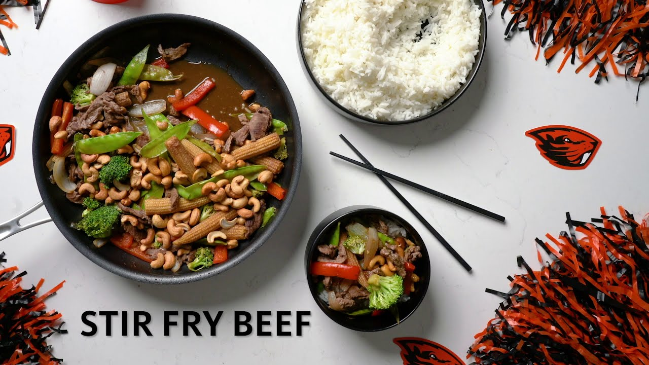 Stir Fry in a pan with chopsticks and rice